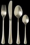 Grupo da tabela da cutelaria de faca de aço inoxidável e de forquilha do jantar da colher de sopa com a colher de sobremesa isola Fotos de Stock
