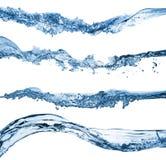 Grupo de água que espirra isolado no fundo branco imagem de stock