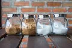 Grupo de açúcar e de açúcar mascavado fotografia de stock