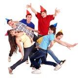 Grupo de adolescente en sombrero del partido. Fotografía de archivo libre de regalías