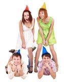 Grupo de adolescente en sombrero del partido. Imagen de archivo libre de regalías