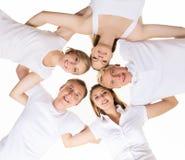 Grupo de adolescentes felices aislados en blanco Imagen de archivo libre de regalías