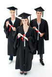 Grupo de adolescentes que celebran después de la graduación Imagen de archivo