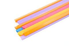 Grupo de aislante colorido de la espina dorsal del libro en el fondo blanco Fotografía de archivo libre de regalías