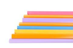 Grupo de aislante colorido de la espina dorsal del libro en el fondo blanco Fotos de archivo libres de regalías