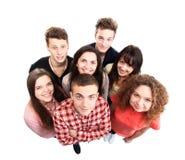 Grupo de amigos alegres felices aislados en blanco Imágenes de archivo libres de regalías