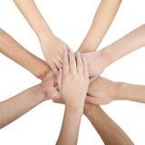 Grupo de amigos chinos con las manos en círculo Fotos de archivo libres de regalías