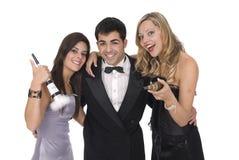 Grupo de amigos de los elegants en un partido del Año Nuevo Fotografía de archivo libre de regalías