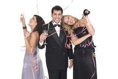 Grupo de amigos en un partido del Año Nuevo Fotografía de archivo libre de regalías