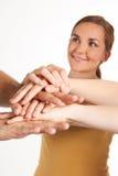 Grupo de amigos novos que juntam-se às mãos junto Fotografia de Stock Royalty Free