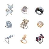 Grupo de anéis dourados com diamantes Imagens de Stock Royalty Free