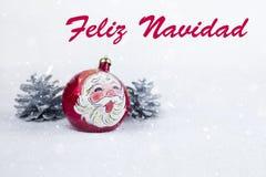 Grupo de bola colorida do Natal com o desenho de Santa Claus e de pinhos com texto no ` espanhol de Feliz Navidad do ` Foto de Stock Royalty Free