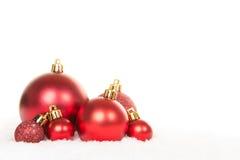 Grupo de bolas de cristal rojas de la decoración de la Navidad Fotos de archivo