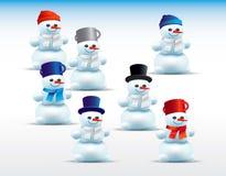 Grupo de bonecos de neve dos desenhos animados Fotos de Stock Royalty Free