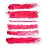 Grupo de borrões vermelhos do batom isolados no fundo branco Produto de composição borrado Fotos de Stock