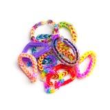 Grupo de braceletes coloridos do elástico isolados no branco Imagem de Stock Royalty Free