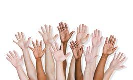 Grupo de brazos humanos aumentados Fotografía de archivo libre de regalías