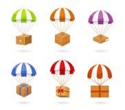 Grupo de caixas levando do paraquedas colorido Foto de Stock Royalty Free