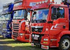 Grupo de camiones brillantes de la demostración Foto de archivo libre de regalías