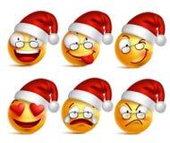 Grupo de cara do smiley de emoticons do amarelo de Papai Noel com expressões faciais e chapéu do Natal ilustração stock