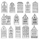 Grupo de casas tiradas mão da garatuja ilustração royalty free