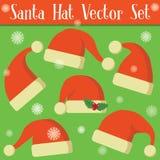 Grupo de chapéus vermelhos de Papai Noel Fotos de Stock Royalty Free