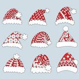 Grupo de chapéus vermelhos de Santa no fundo branco para o elemento do projeto e a página do livro para colorir Ilustração do vet Foto de Stock Royalty Free