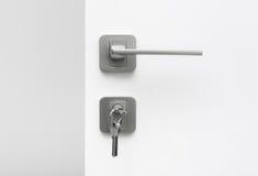 Grupo de chaves no buraco da fechadura Foto de Stock