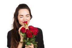Grupo de cheiro da mulher das rosas fotografia de stock royalty free