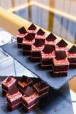 Grupo de chocolate escuro com partes brancas do creme e do chocolate Foto de Stock Royalty Free