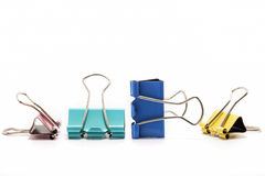 Grupo de clipe de papel de quatro cores isolado no fundo branco Fotografia de Stock Royalty Free