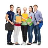 Grupo de colocación sonriente de los estudiantes Imagen de archivo libre de regalías