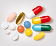 Grupo de comprimidos e de farmácia diferentes das cápsulas Imagem de Stock