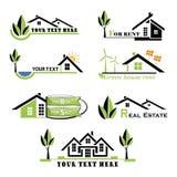 Grupo de ícones das casas para o negócio dos bens imobiliários no fundo branco Fotografia de Stock