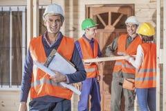 grupo de construção de 4 pessoas Fotos de Stock