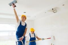Grupo de construtores com ferramentas dentro Fotos de Stock Royalty Free