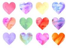 Grupo de corações coloridos da aquarela ilustração stock