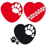 Grupo de corações com as patas do cão no fundo branco Fotografia de Stock Royalty Free