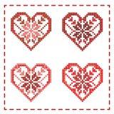 Grupo de corações com os ornamento feitos fora da cruz Foto de Stock