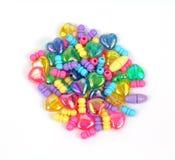 Grupo de corações e de grânulos metálicos Fotografia de Stock