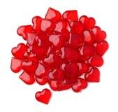 Grupo de corazones plásticos rojos aislados Fotos de archivo libres de regalías