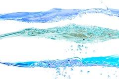 Grupo de cores azuis das ondas de água no fundo branco Fotos de Stock Royalty Free