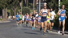 Grupo de corredores na estrada (a fome corre 2014, FAO/WFP) Fotografia de Stock Royalty Free