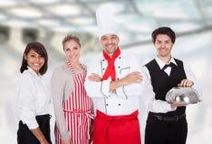 Grupo de cozinheiro chefe e de empregados de mesa Foto de Stock Royalty Free