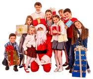 Grupo de crianças com Papai Noel Foto de Stock Royalty Free