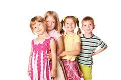 Grupo de crianças pequenas que jogam e que sorriem. Fotos de Stock