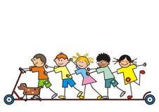 Grupo de crianças em um 'trotinette' Fotografia de Stock Royalty Free