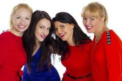 Grupo de cuatro atractivos, mujeres felices jovenes hermosas Aislado en whi foto de archivo libre de regalías