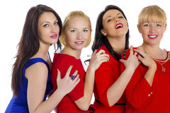Grupo de cuatro atractivos, mujeres felices jovenes hermosas Aislado en whi imagenes de archivo