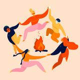 Grupo de dança e de salto dos jovens em torno do fogo ilustração stock